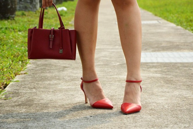 small red handbag, red ankle strap heels