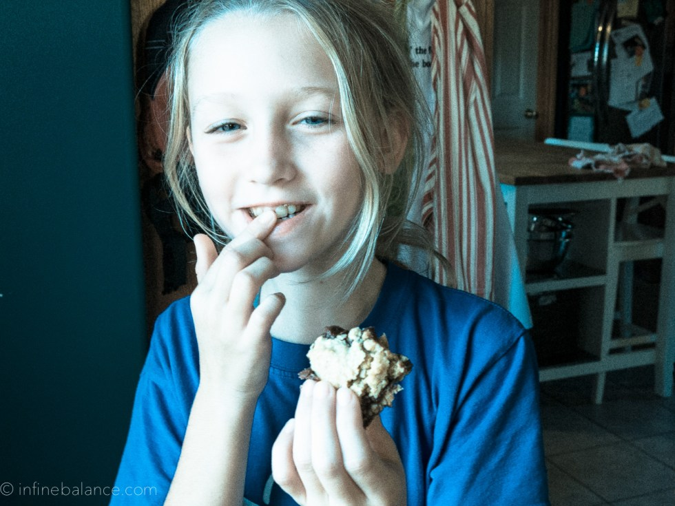 girl eating a oat fudge bar