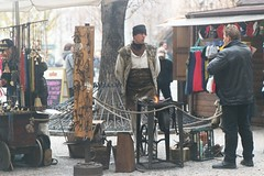 Prague 2002: A fur coated blacksmith presents ...