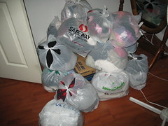 Great big piles of clothes to donate
