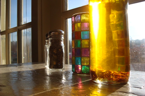 Sun on stained glass and oil