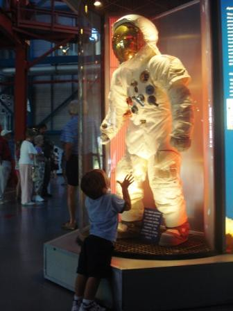 Cutie Looking Up in Awe of an Astronaut Suit