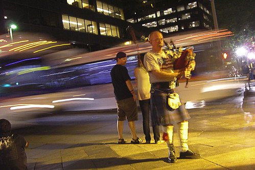 Bagpiper and Bus