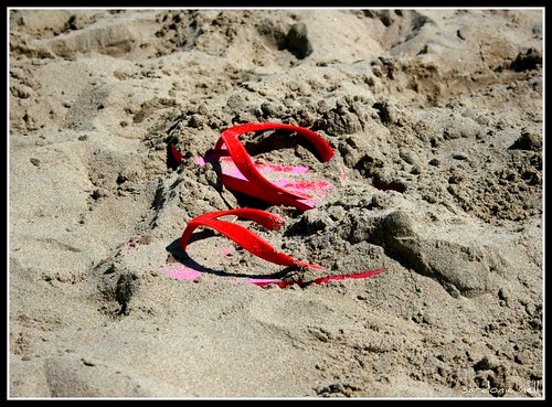 Flip Flops On A Sandy Beach