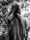 Statue at Pere Lachaise Graveyard in Paris