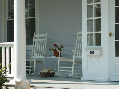 A idyllic porch with rocking chairs