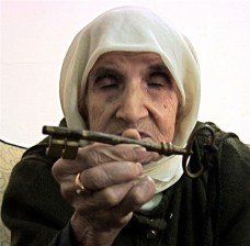 Palestinian Refugee, Beddaui camp, N. Lebanon, with the key to her house from which she was forcibly expelled in 1948, © 2008 JANE FRERE