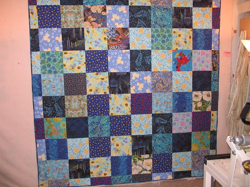 10 inch squares on back of pineapple blossom quilt