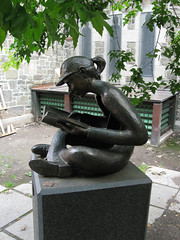 statue in a churchyard beside the convention center