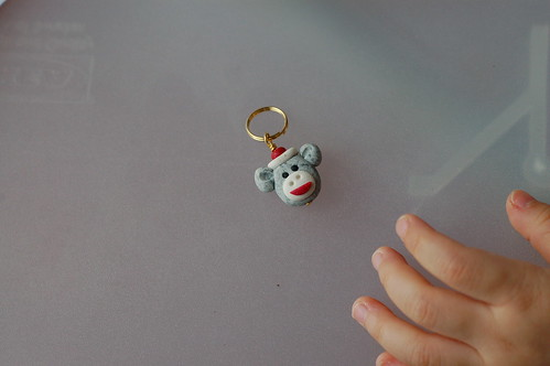 little monkey stitch marker... with Erikas little hand... She cant resist to touch it...