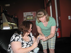 Heather teaching Kimberly how to knit at the Sit & Knit