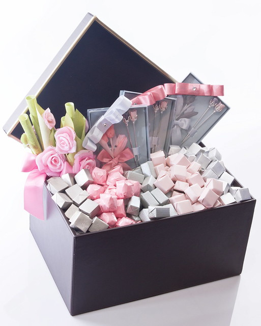 Classy leather box with chocolates decorated with silk flower and ribbons