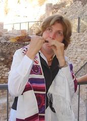 Anat blows the shofar