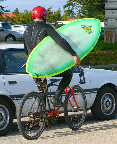 Surfer on bicycle