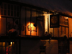 The Six Bells pub sign under snow