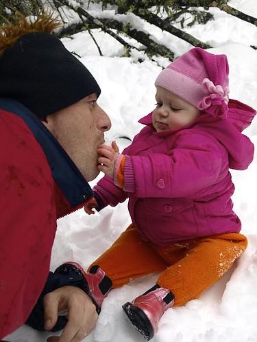 Tiily feeding Daddy snow