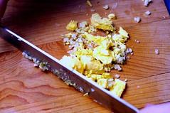 mincing yolk with garlic and salt