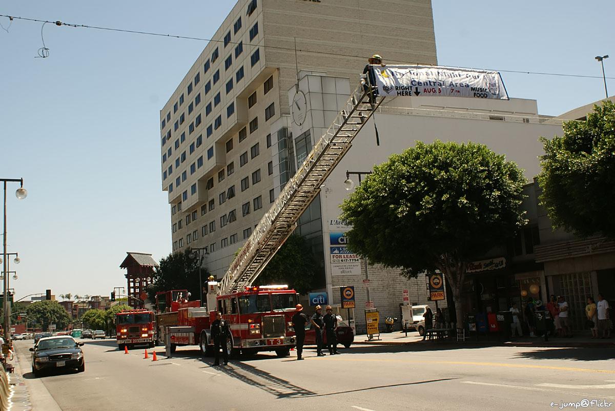 Fireman putting up banner