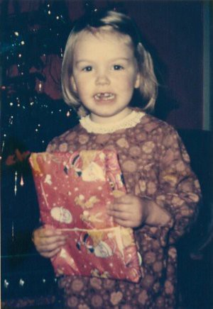 opening a christmas present in 1976 (no giggles about the curtains im wearing please)