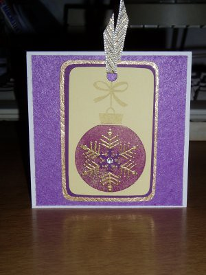 I didnt have quite enough of the blue card that i printed the smaller baubles on, so i printed one on another shade of blue, but i didnt like them together in the end up. (Ill use that one somewhere else). So i created a card with just the one bauble on instead, using purple felt as a background. i think it works well.