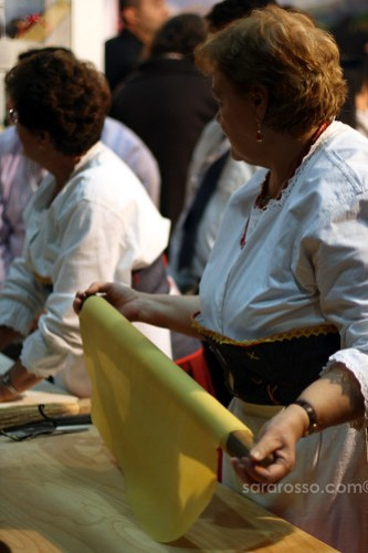 Rolling out pasta by hand at Salone del Gusto in Turin