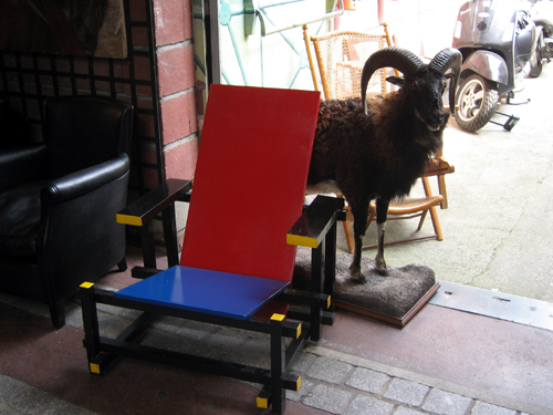 '80s chair and stuffed mountain goat