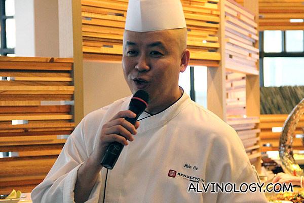 Straits Cafe head chef greeting everyone