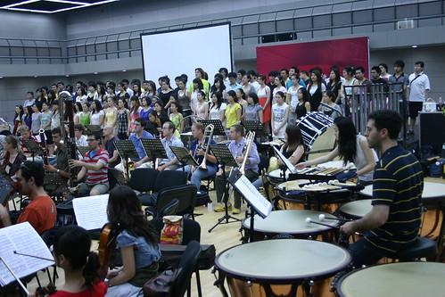The CCOM Chorus rehearses with the orchestra