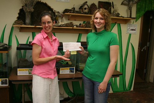 Sarah gives Scholarship Check to Tricia!