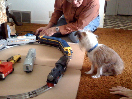 Spike helps Grandpa Doug with the trains