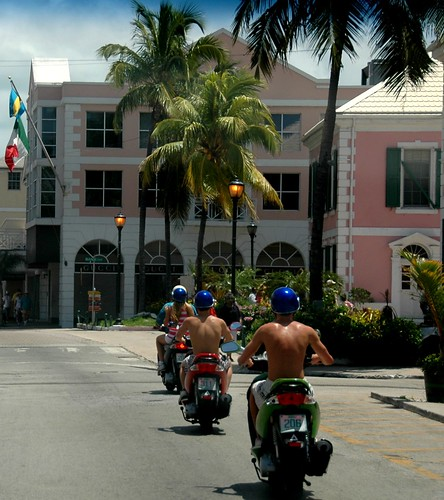 a photo of the streets of nassau a city in the bahamas with motorcycle riders