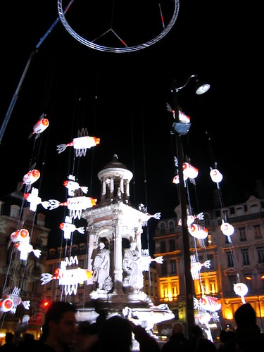 A fountain decorated with light-up fish.