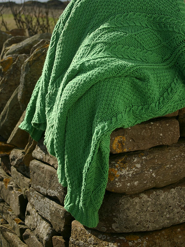 Green Sweater and Rocks