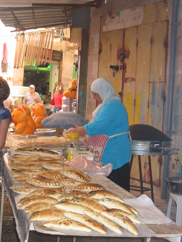 Woman selling bread in Akko, Israel