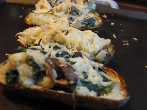 Twice-baked potatoes with sauteed spinach and mushrooms.