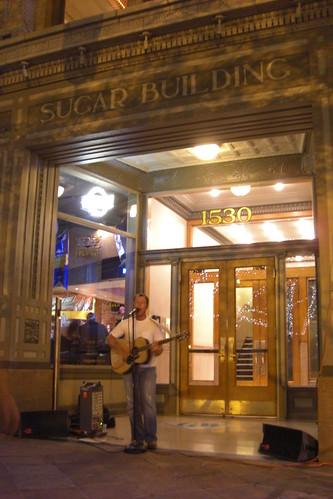 A Man, Guitar and Sugar Building