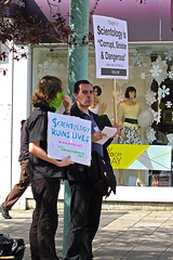 Martin and Anonymous stand with placards in Plymouth city centre