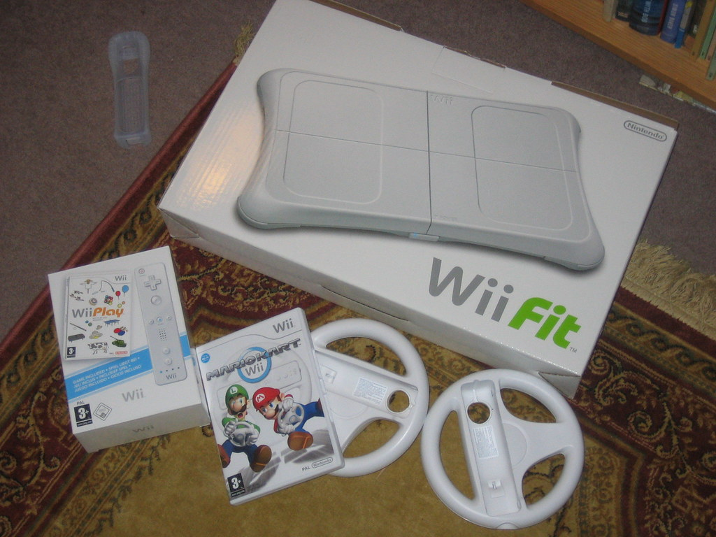 A bunch of Wii stuff. Wii Play and Wii Fit belong to my brother and mother espectively, but MarioKart is MINE.