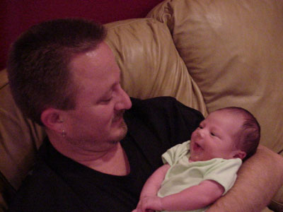 Calvin with infant Robert.  Man, we had a crappy digital camera back then.