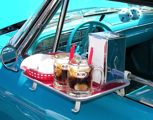 This photo brings back memories of when the carhops would bring our order to car in a tray like this.