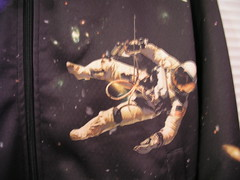 An astronaut on the front of my cool new hoodie - it has the Atlantis Space Shuttle on the back