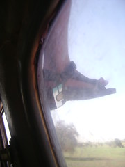 Cedrics foot hanging off the top of the car