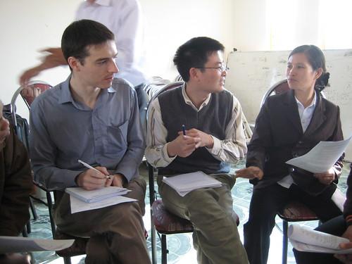 SRD staff speak with a key farmer from Cao Xa commune.
