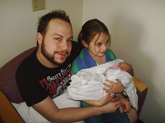 Papa Mikey with Isabella and her new baby sister