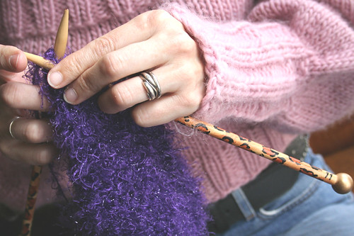 Mom knitting with her leopard print needles