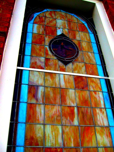 A stained glass on the side of the building