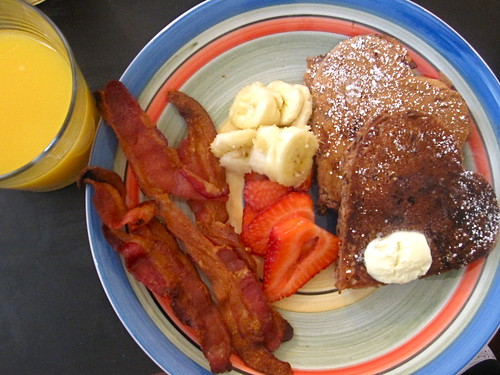 Heart-shaped Banana Kona Chocolate Chip Pancakes (breath), Fresh Banana & Strawberries, Bacon, & OJ