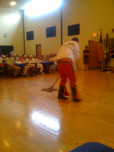 A Moravian Cultural Society Dancer mopping the floor