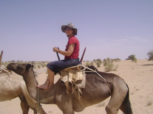 Riding a camel in the desert near Timbuktu