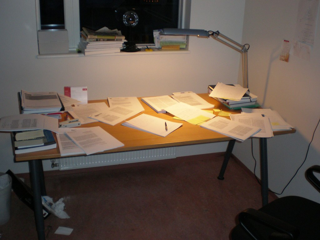 a picture of a messy desk